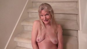 American milf April Pallid teases will not hear of nyloned pussy