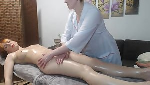 Homophile matured pleased redhead girl with a rub down