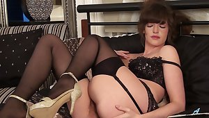 Dirty mature wife Kate Anne moans while fingering her hairy pussy