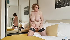 Solo mature Camilla Creampie takes missing will not hear of red panties to make believe